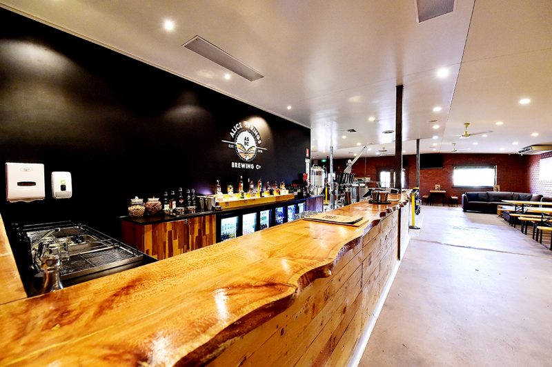 This is the bar at the Alice Springs Brewing Co showing the brewing equipment in the background
