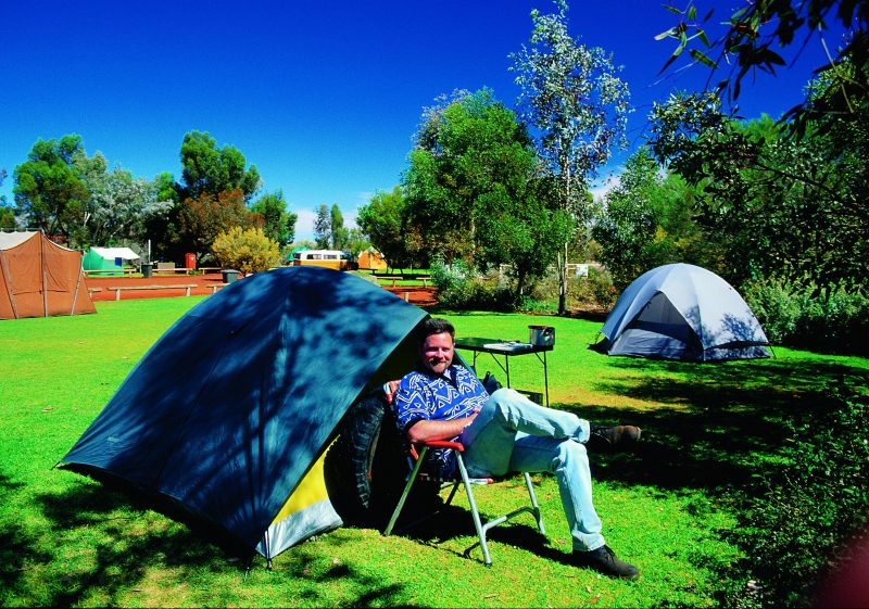 Pitch your tent on lush green grass under the shade of native desert oaks.