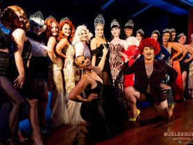 The state Burlesque Idol winners pose with the Australian winner, along with the producer and ambass