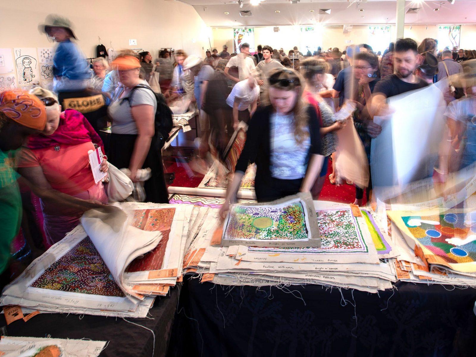 crowds buying Aboriginal art work at art fair