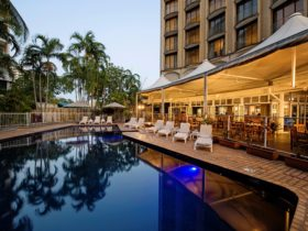 Dine at Poolside Restaurant by the outdoor pool
