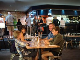 A family enjoying a meal at escarpment restaurant and bar