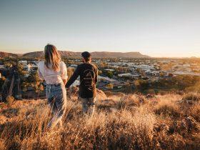 A young couple walking down ANZAC Hill