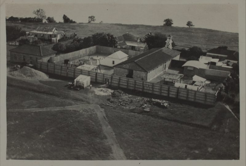 1930s Fannie Bay Gaol. Note quarry and watch tower.
