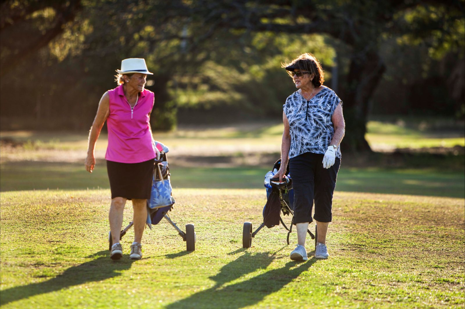 Lovely ladies playing a game at gardens park golf links