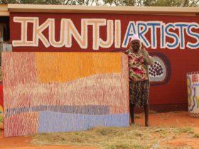 Artist Eunice Napanangka Jack with artwork