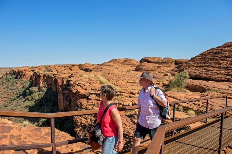 A man and a woman crossing a pedestrian bridge enjoying the view over Kings Canyon