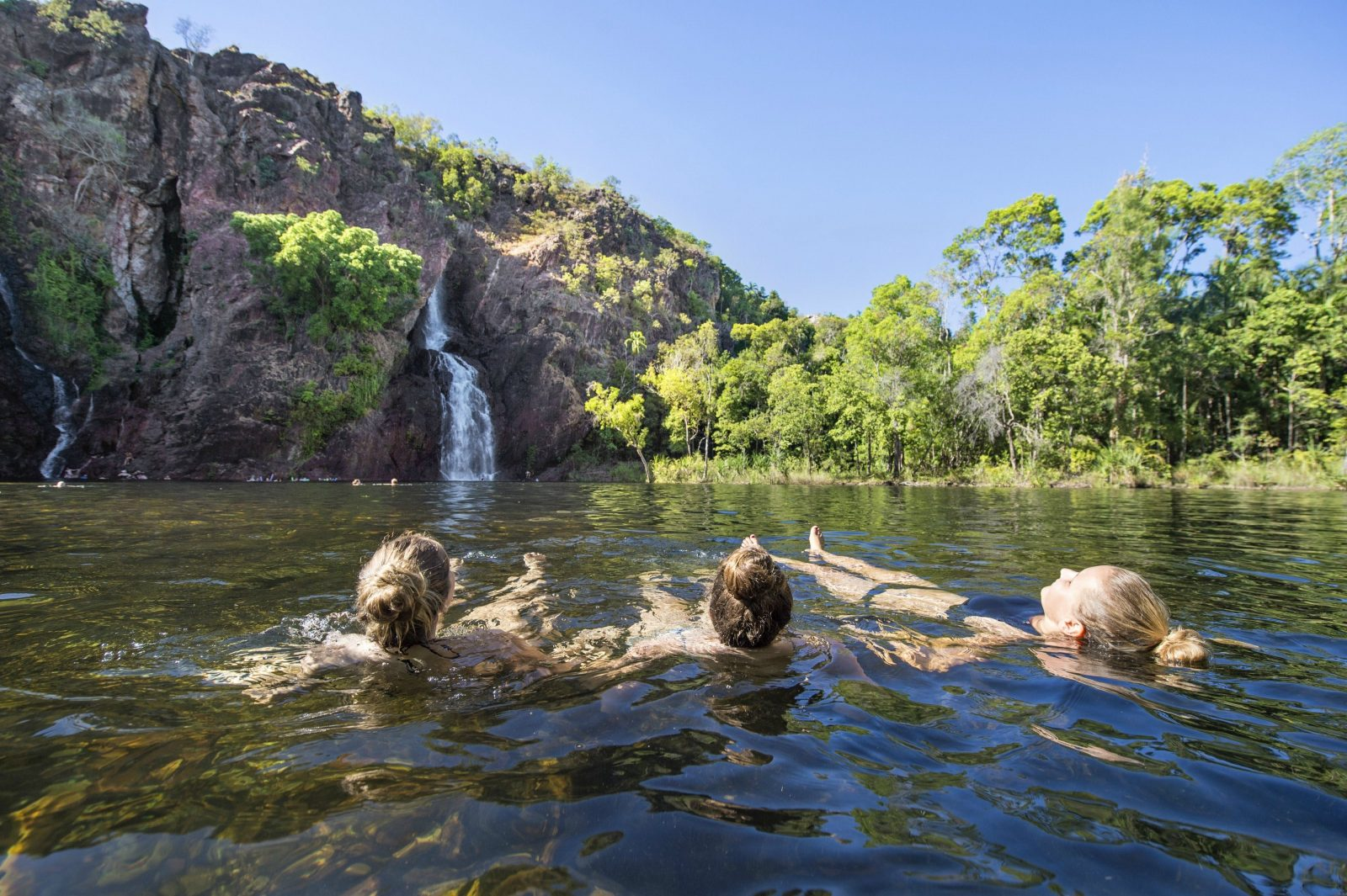Three visitors enjoying Wangi Falls, Litchfield National Park