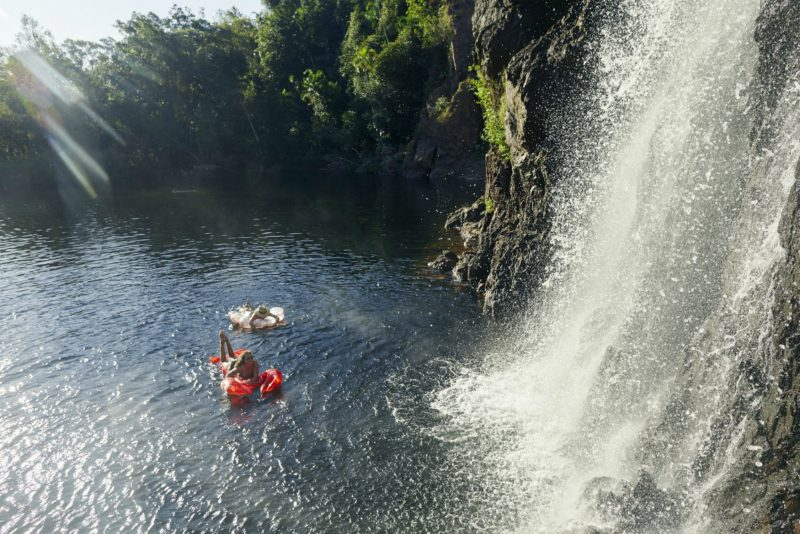 Two girls floating on blow up rings at Wangi Falls