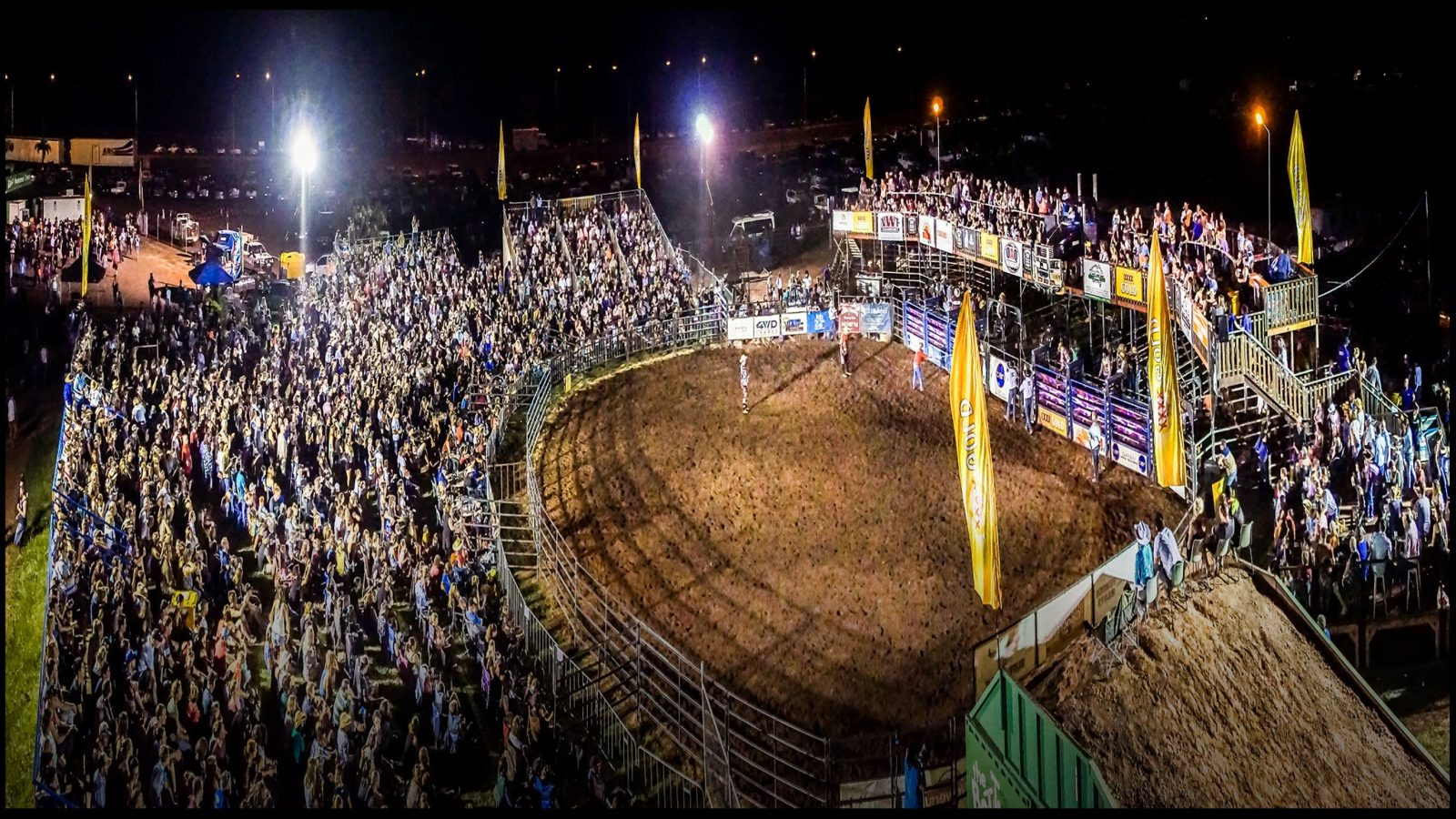 An ariel view of the Rodeo showing the arena in the middle with a large crowd around the outside