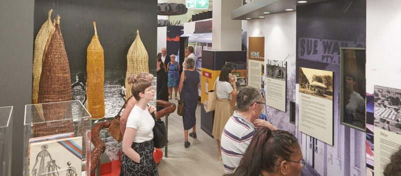 Exhbiiton corridor with people looking at displays