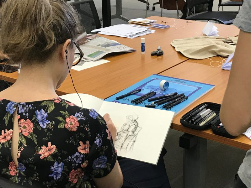 Artist sketching scene around them