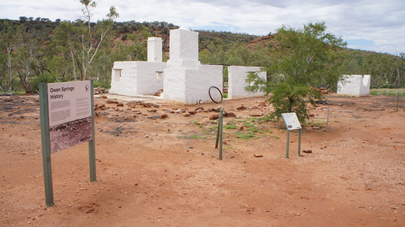 Old Owen Springs Homestead site, showing some interpretive signage and wire fencing around buildings