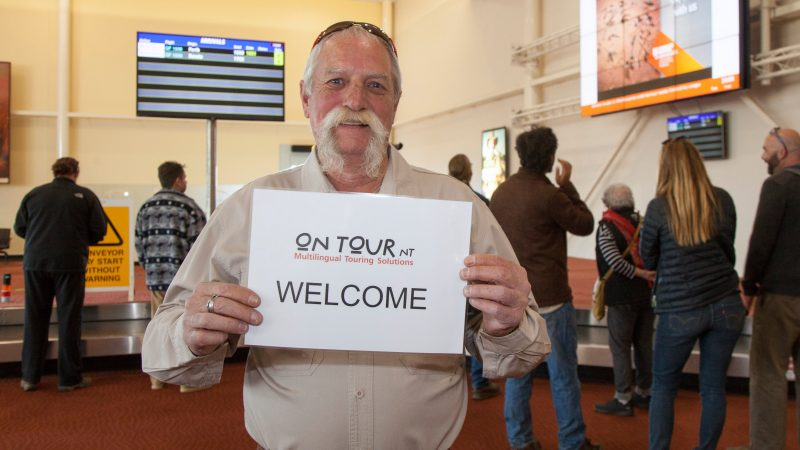 Tour Guide Welcoming Passengers