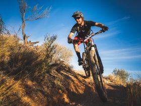 Man riding mountain bike down a rocky path