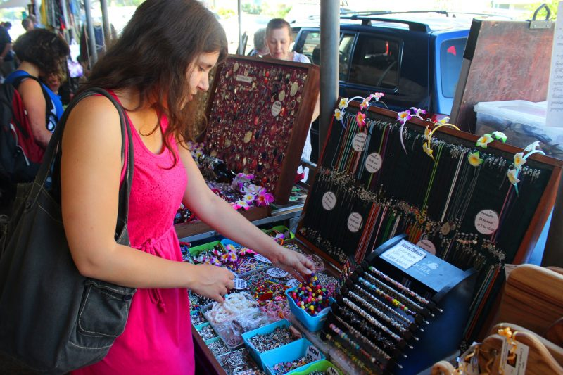 Woman standing and looking at jewellery at the markets