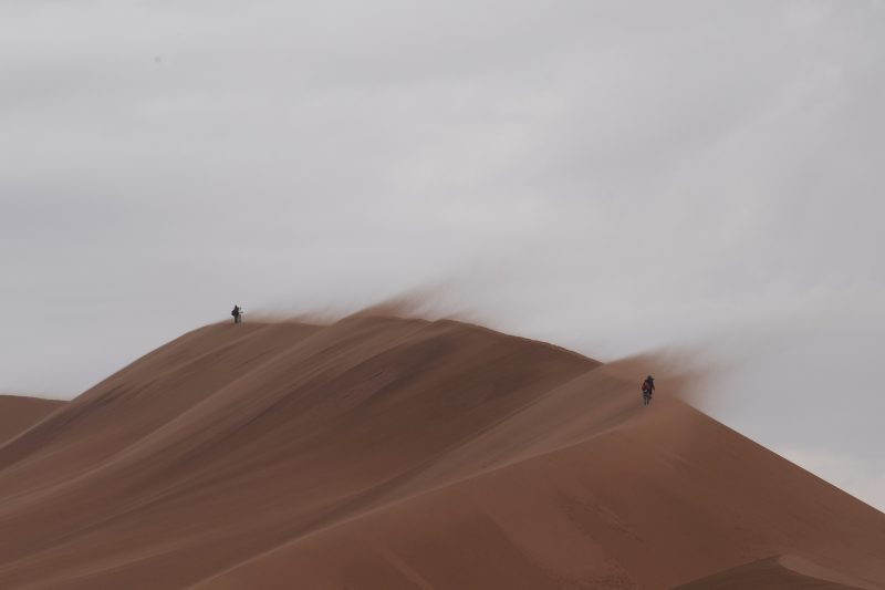wind blowing over a sand dune
