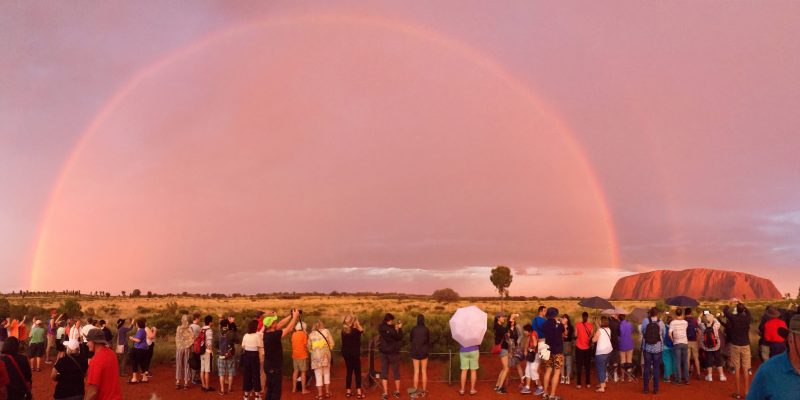 Sunset at Uluru with a large rainbow