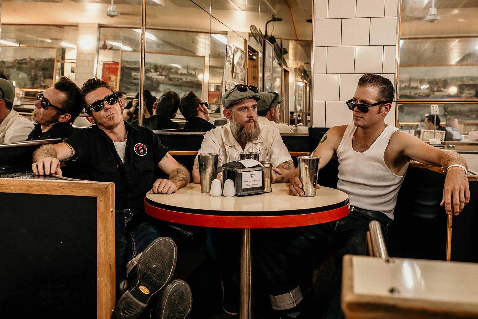 Three blokes in a vintage Milk Bar Diner