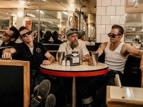 Three blokes in a vintage Milk Bar Diner