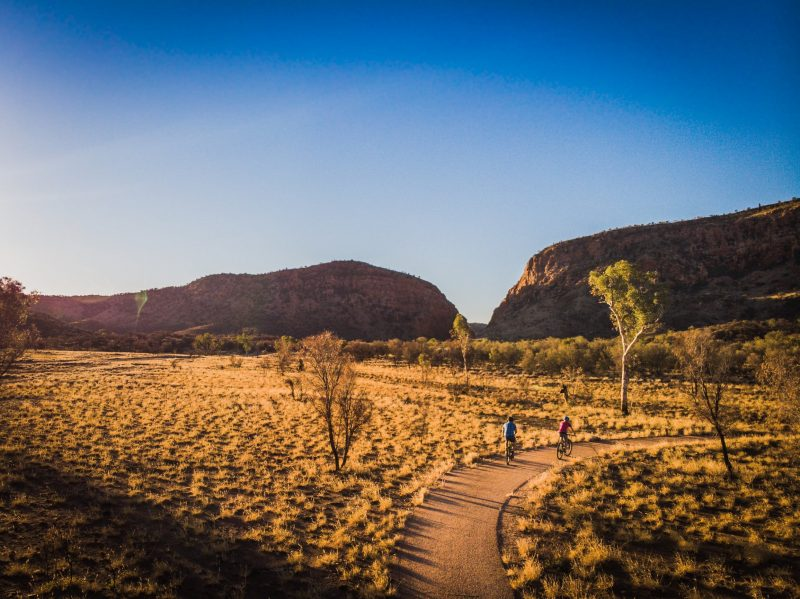Visitors riding on Simpsons Gap bike path towards Simpsons Gap
