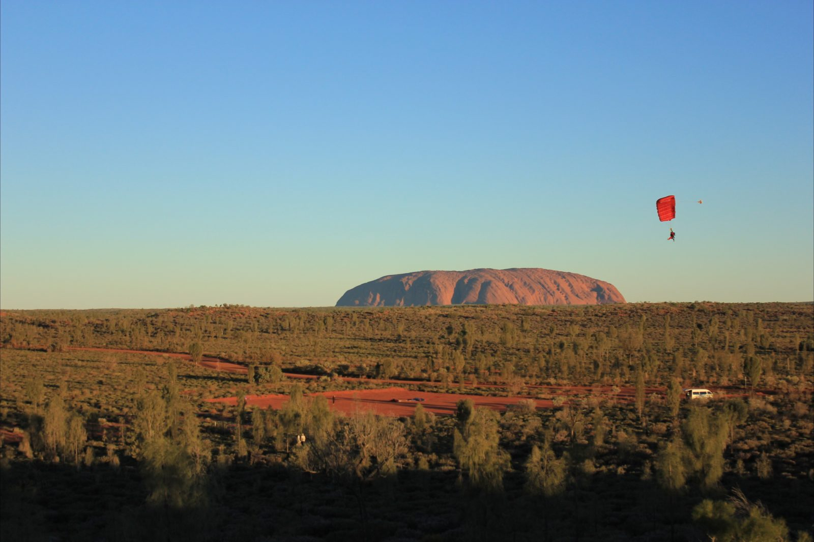 Skydive Uluru Ayers Rock parachute landing on Red Centre Drop Zone with Uluru in the background.