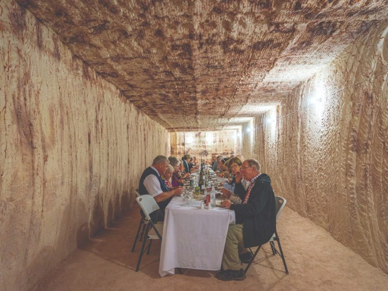Guests enjoying underground dining experience in Coober Pedy