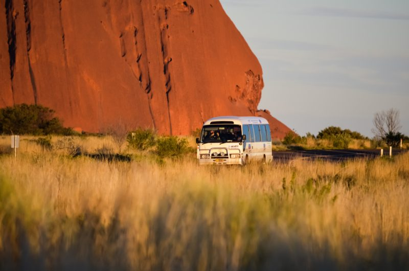 Uluru Hop on Hop off bus at the base of Uluru