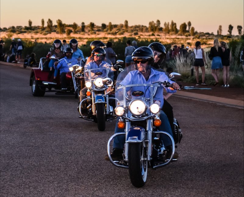 Harleys and Trike arriving for sunset at Uluru