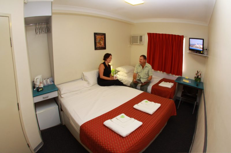 Value Inn Standard Room featuring 1Q and 1S bed. Rooms are compact and feature a TV, air conditioning, bar fridge, tea & coffee making facilities and ensuite