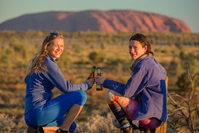 Enjoy Uluru at sunset with your tour group