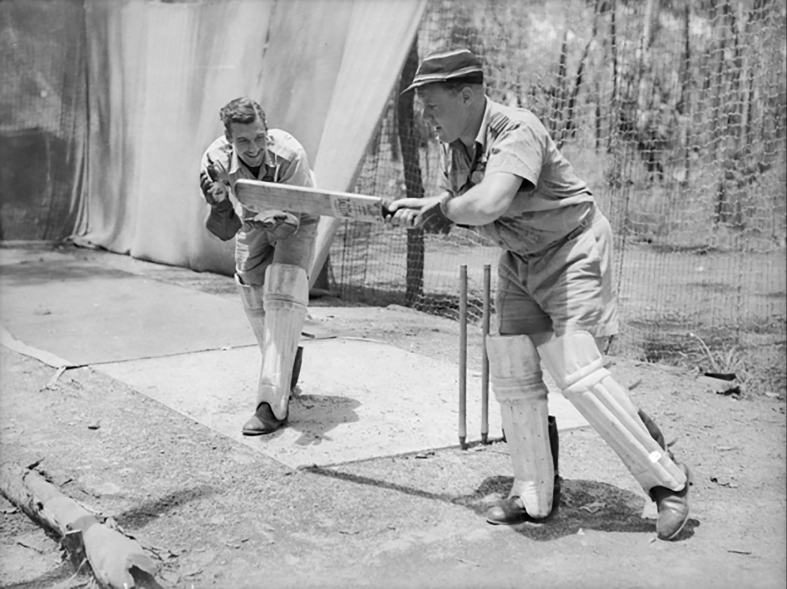 1943 - Sqn Leader Bluey Truscott batting, Flying Officer EB Tainton keeping.