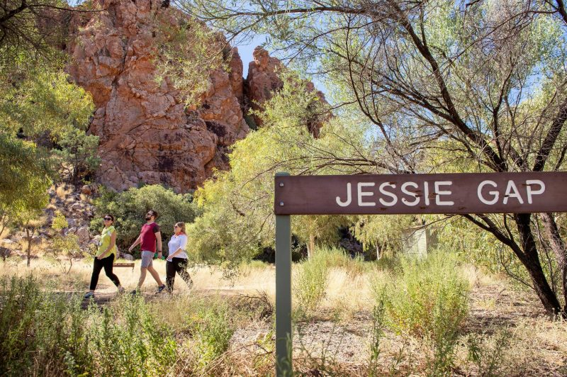 Visitors walking past a sign saying Jessie Gap