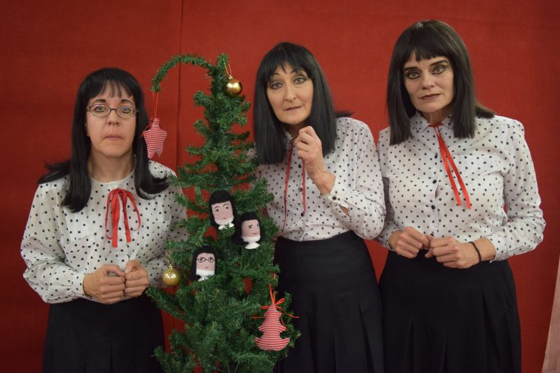 Kransky Sisters Standing Next To Christmas Tree
