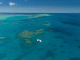 Aerial shoot with our boat at a remote outer reef location, no other boats in sight.