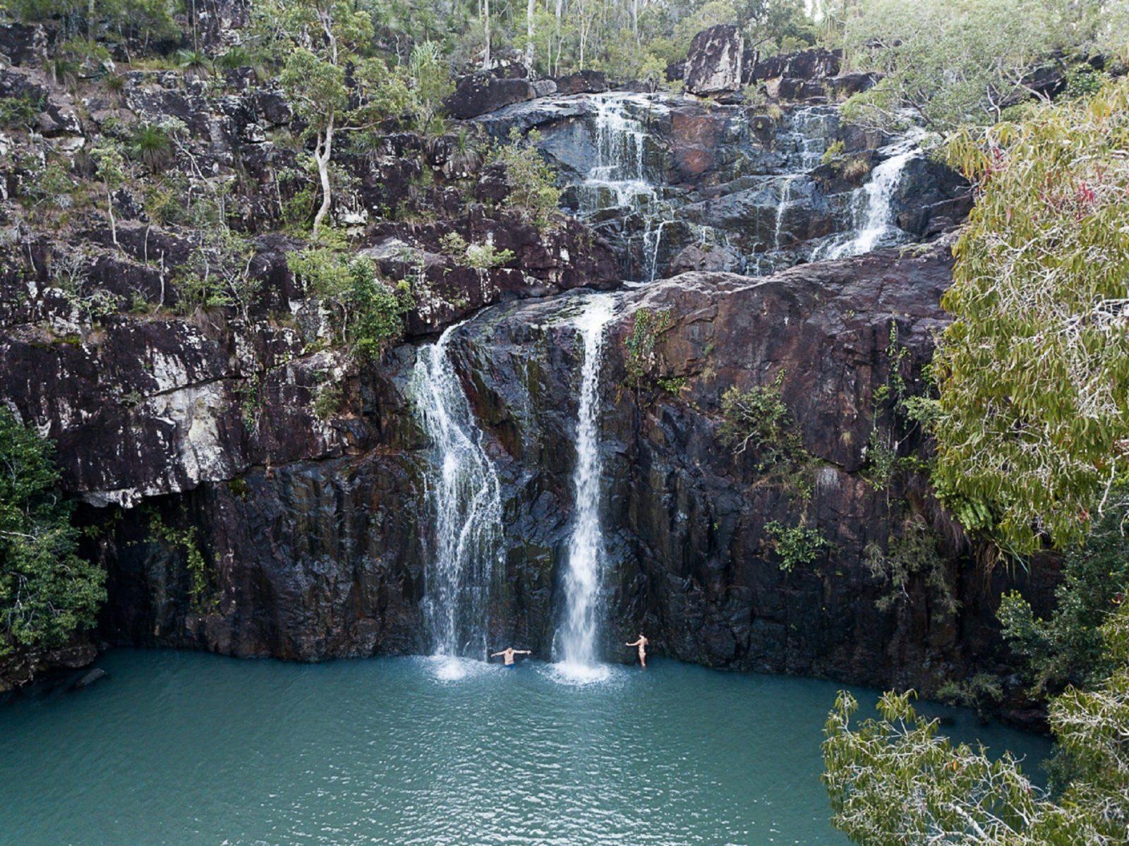 Swim beneath refreshing waterfalls
