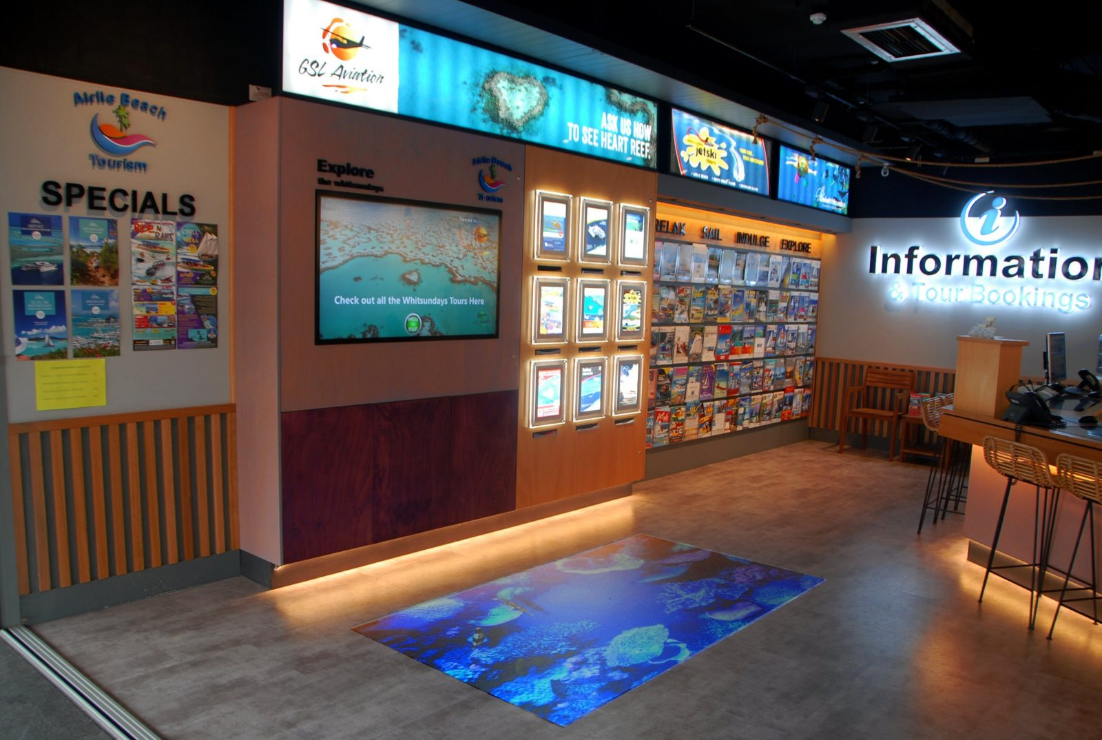 Airlie Beach tourism Interactive touch screen and brochure wall