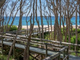 Our private boardwalk leads you onto Home Beach, Point Lookout.