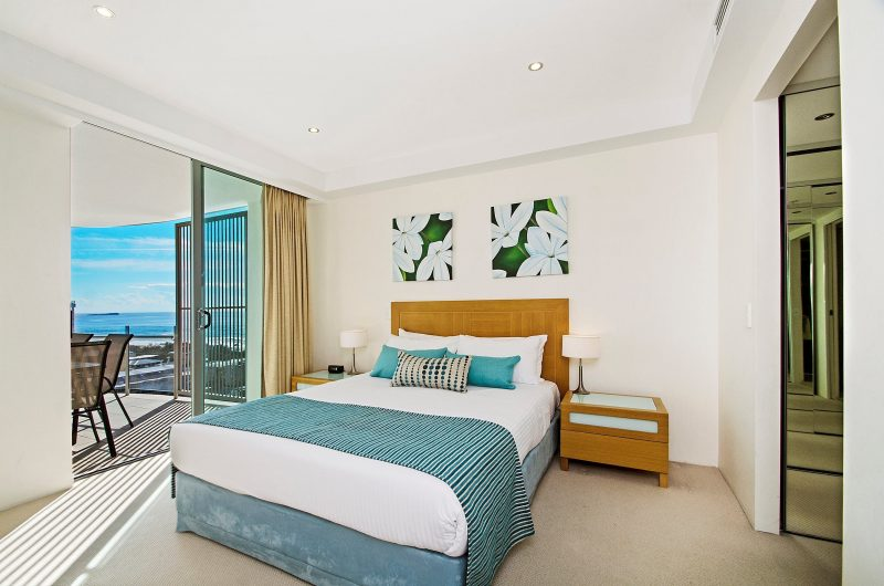 Double bed and balcony with ocean views. Bedroom also has ensuite and walk-in wardrobe