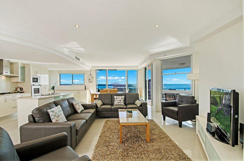 Oversized furniture around the home theatre enhanced television at Aqua Vista Luxury Resort