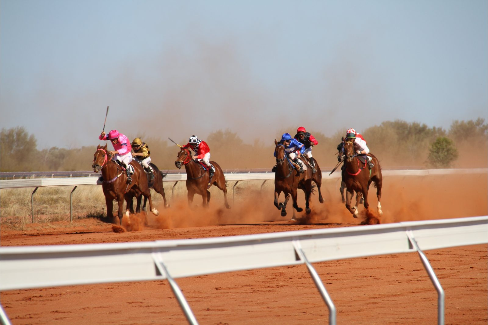 Bold colours and horses galloping down the track at the annual Jundah races.