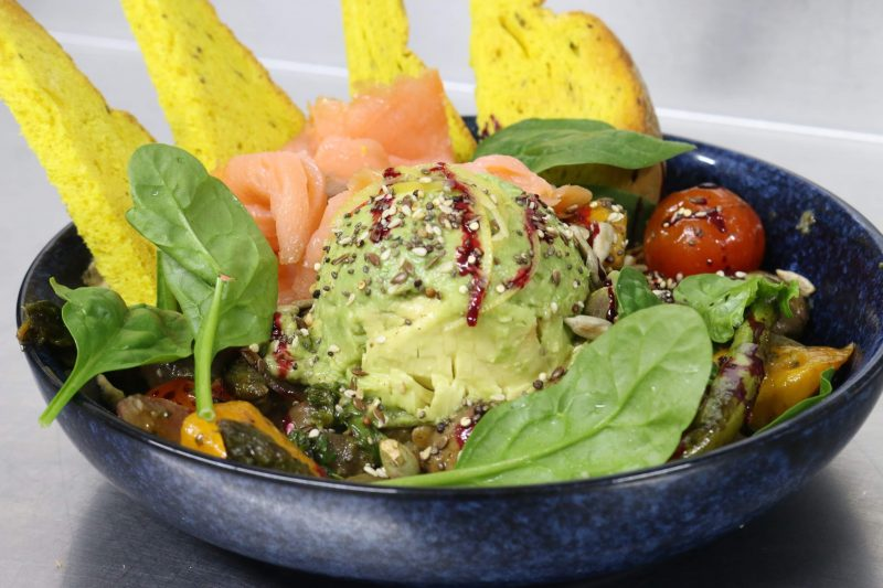 Vegan Buddah Bowl with roast veg, hummus, avo, tumeric sour dough and topped with mixed seeds