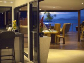 Alfresco Dining on the Large Expansive Undercover Deck over the Coral Sea and two private beaches