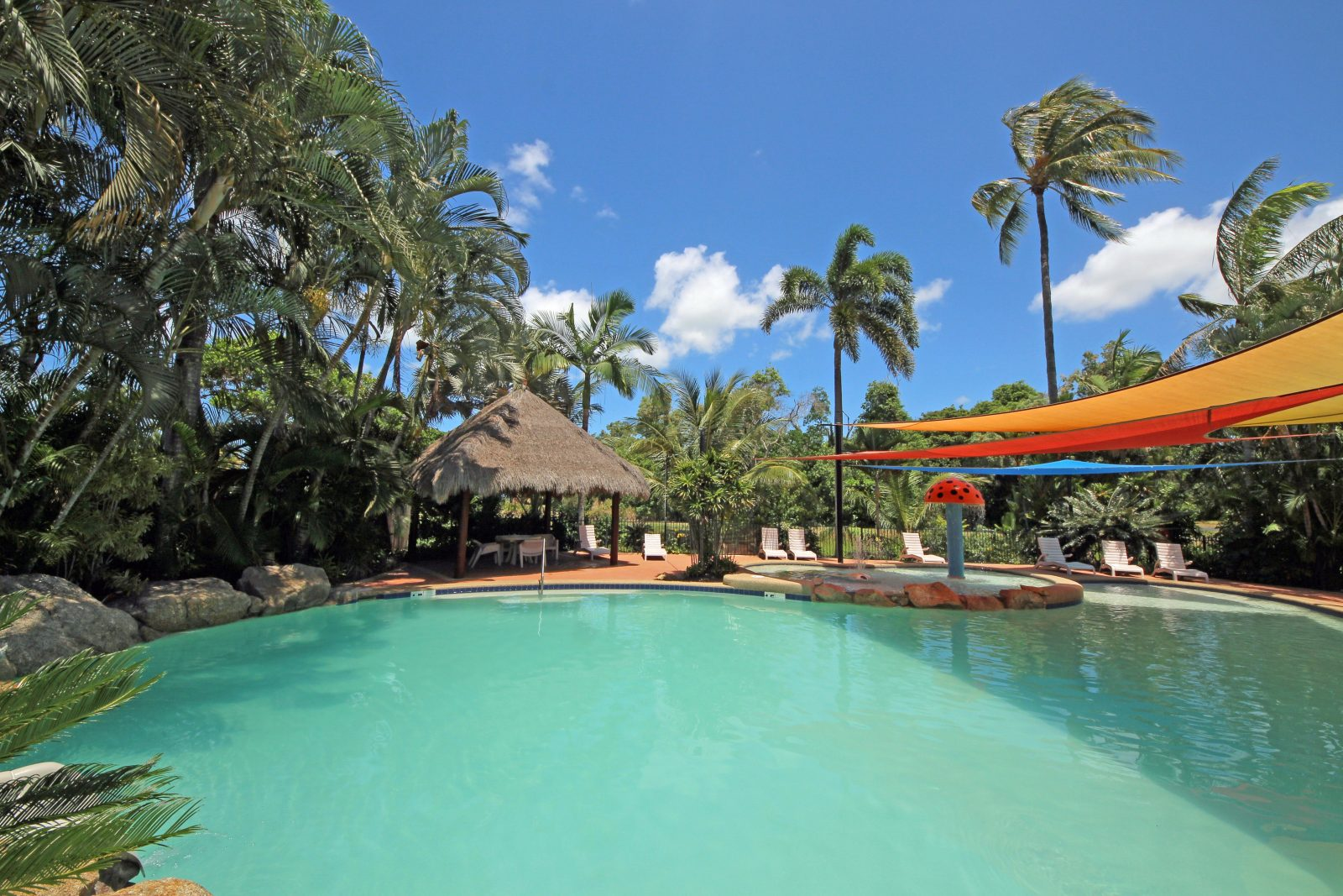 Resort style pool with children's wading area and pool slide
