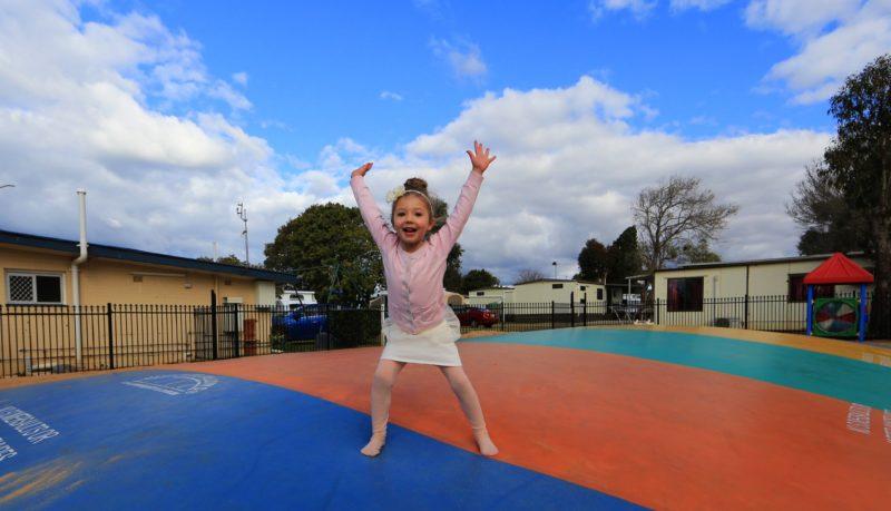 Girl having fun on jumping pillow at BIG4 Toowoomba Garden City Holiday Park