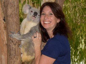 Twice a day pose with a koala for a memorable souvenir photo