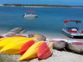Pontoon Boat on the Beach ready for hire in the beautiful Pumicestone Passage, Caloundra