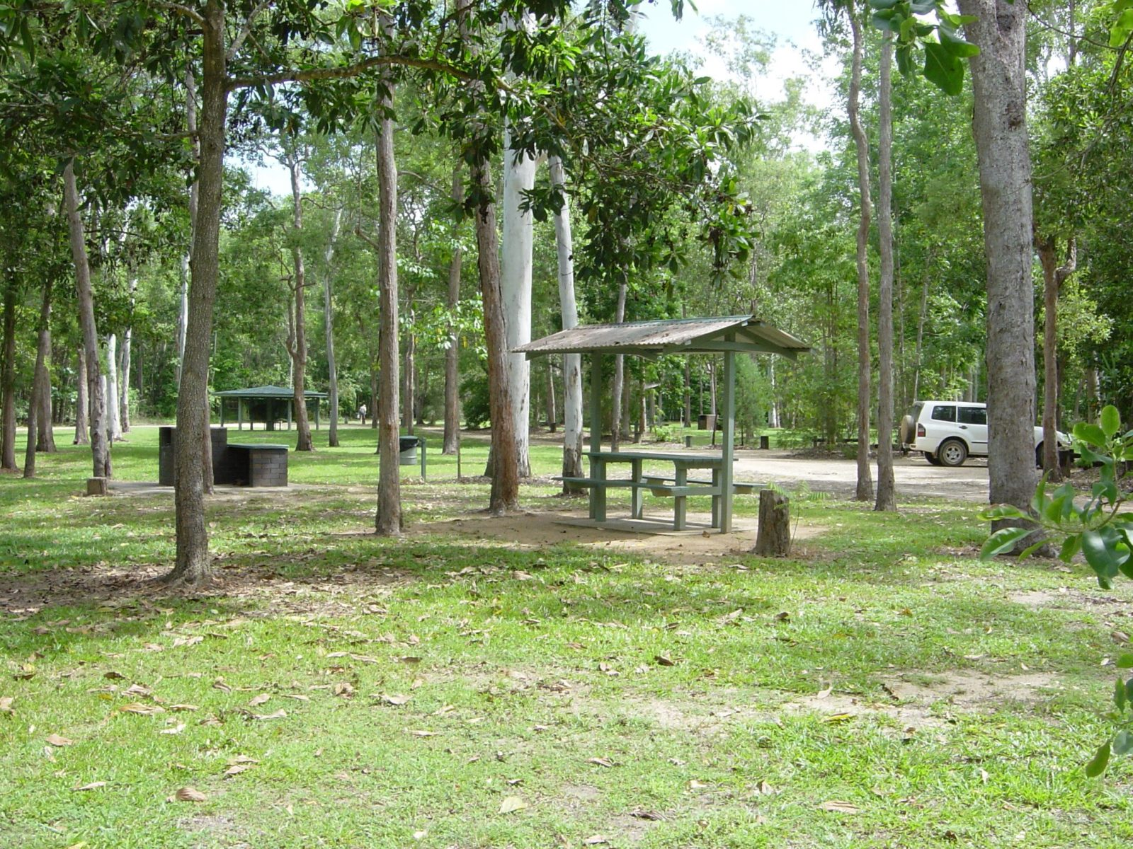 Barbeques and picnic shelters at day use area near camping area.
