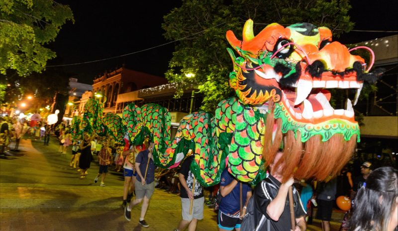 Community Members join in a colourful lantern parade.