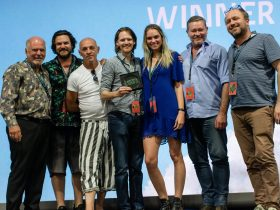 CAPS World short film winner Brendan Kelly surrounded by judges.